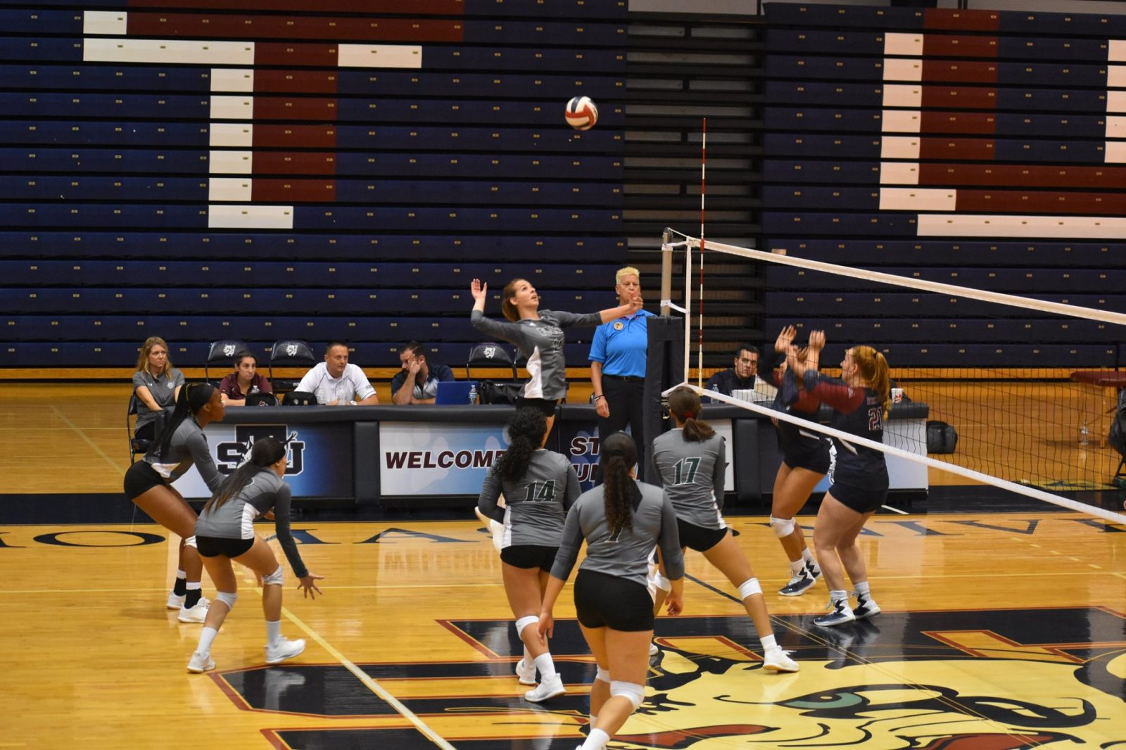 fnu volleyball player attacking the ball during the game against st. Thomas
