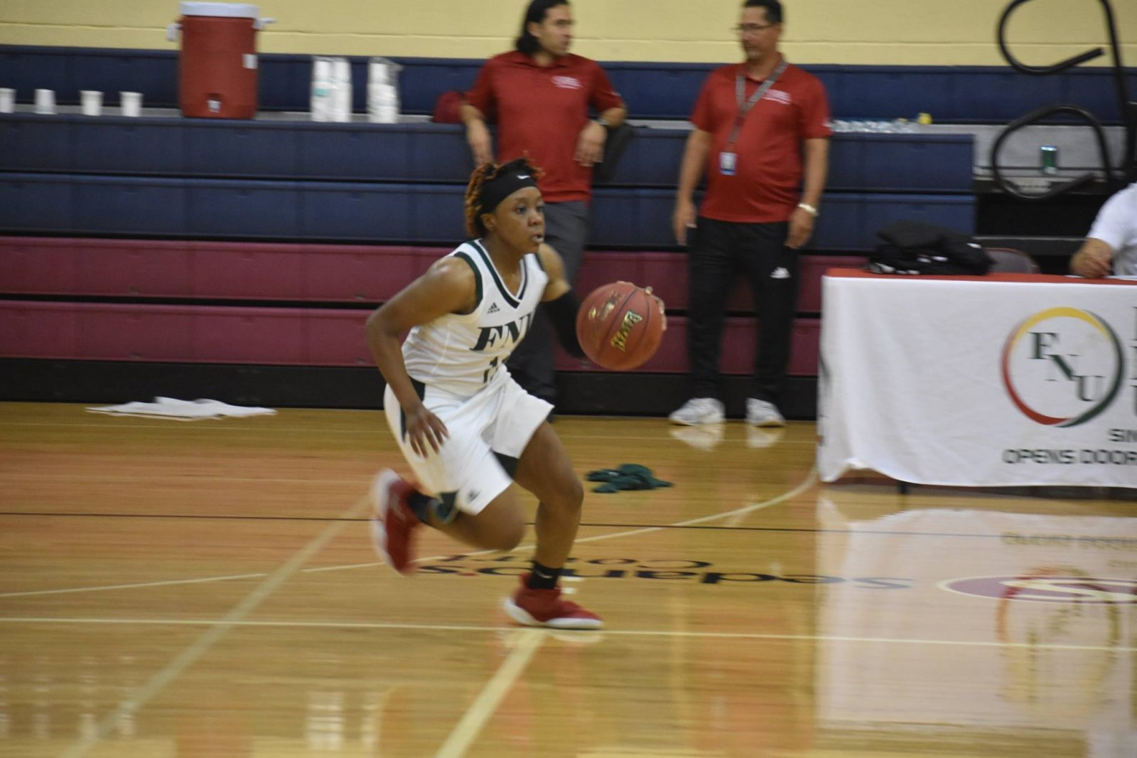FNU Women's Basketball Player dribbling the ball