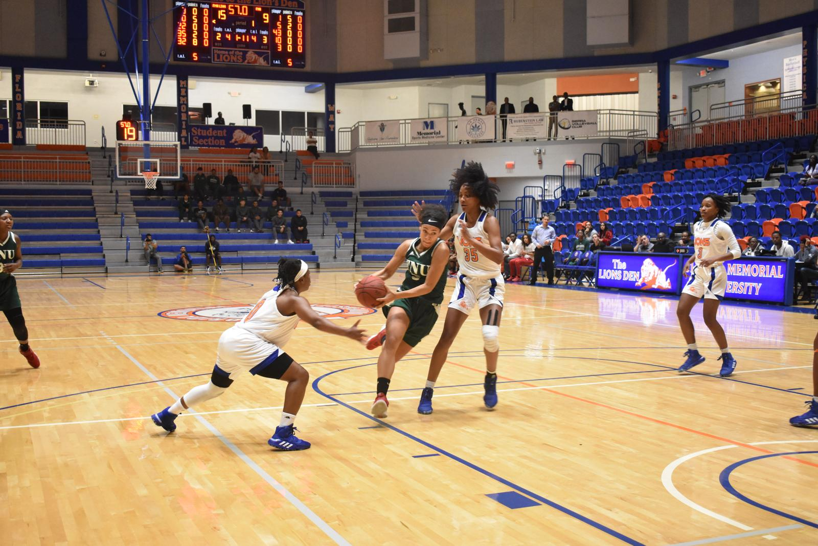 FNU women's basketball player Shannon Rosensteel dribbling the ball during the game against FMU