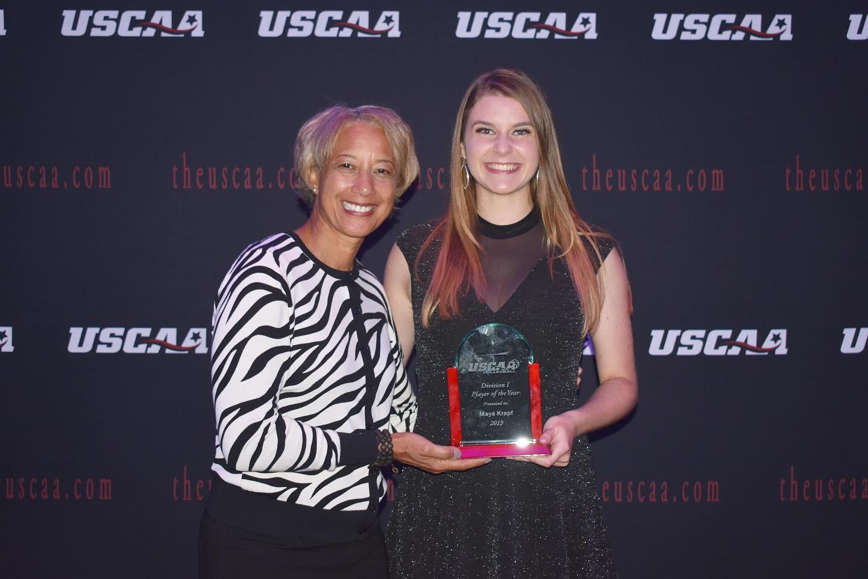 Maya Krapf receiving USCAA Player of the year award