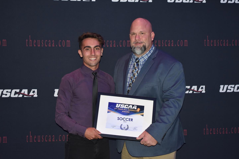 Men's Soccer player Martin Marijuan receiving All-American second team Award