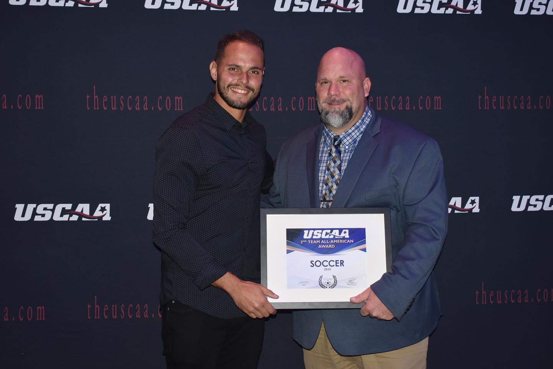 Men's Soccer player Rodrigo Festuccia receiving All-American second team Award