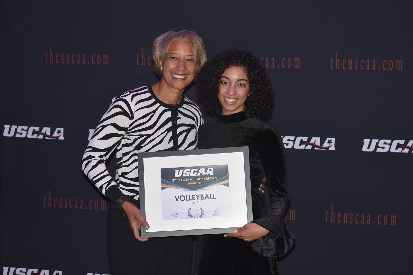 Women's Volleyball player Andrea Romero receiving All american second team Award