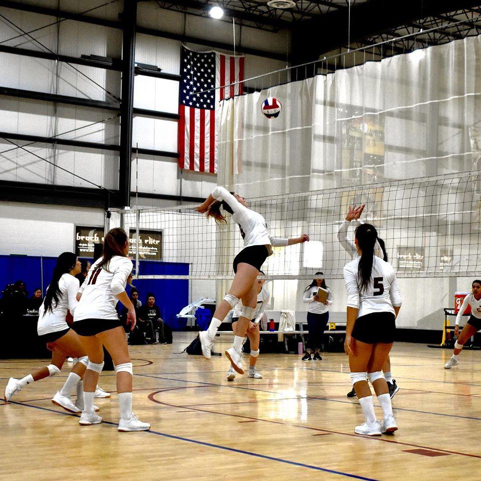 Volleyball player Maya Krapf Attacking the ball