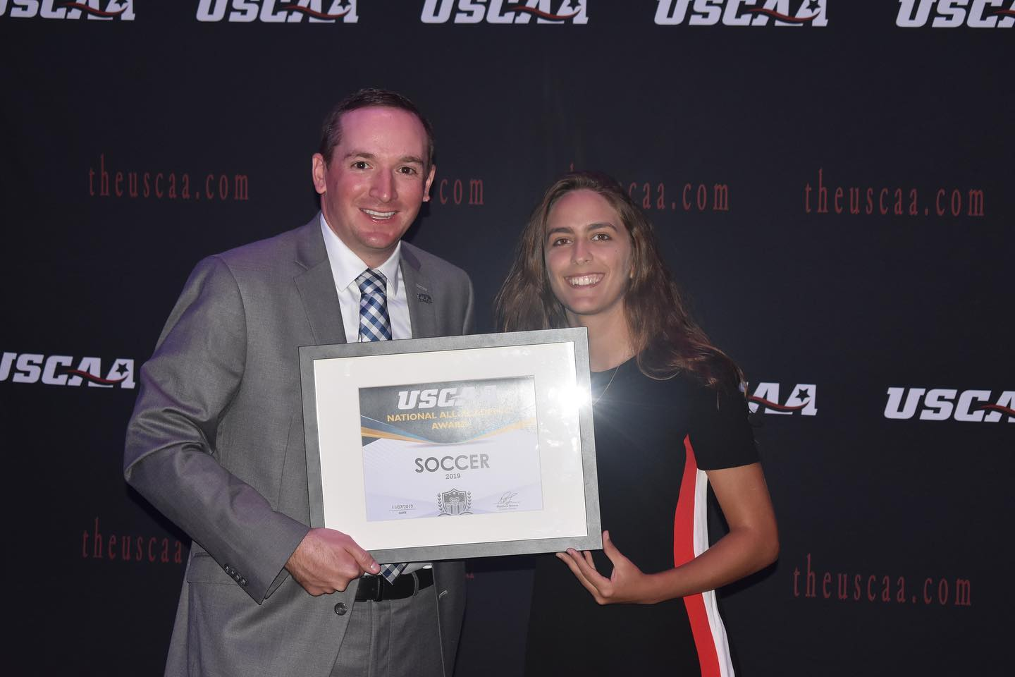 Women's soccer player Bethania Cruz Receiving the All-Academic award