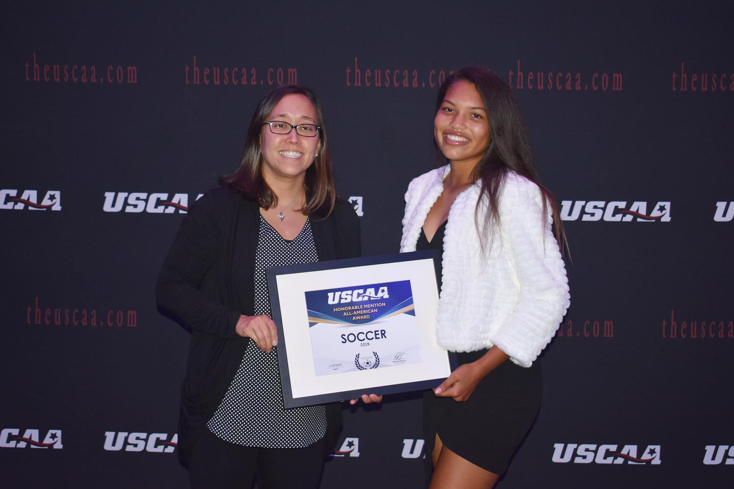 Women's soccer player Dominique Mosley Receiving the All-American second team award