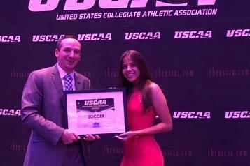 Women's soccer player Noriann Gaviria Receiving the All-Academic award