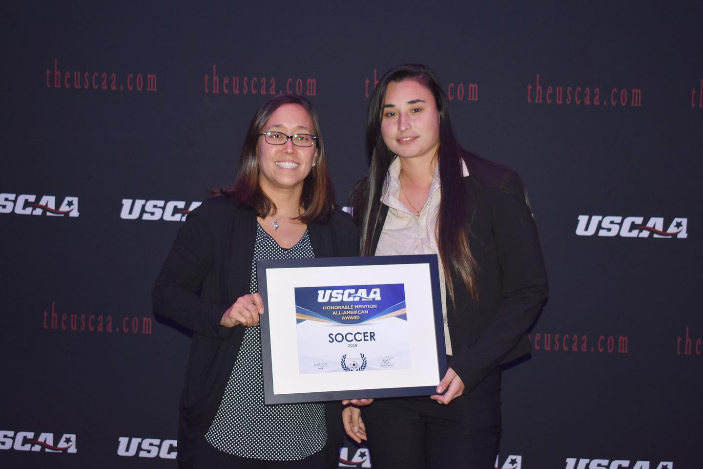 Women's soccer player Vanessa Osorio Receiving the All-American second team award