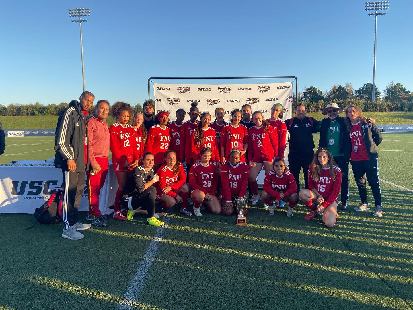 Women's soccer team with the runner up trophy