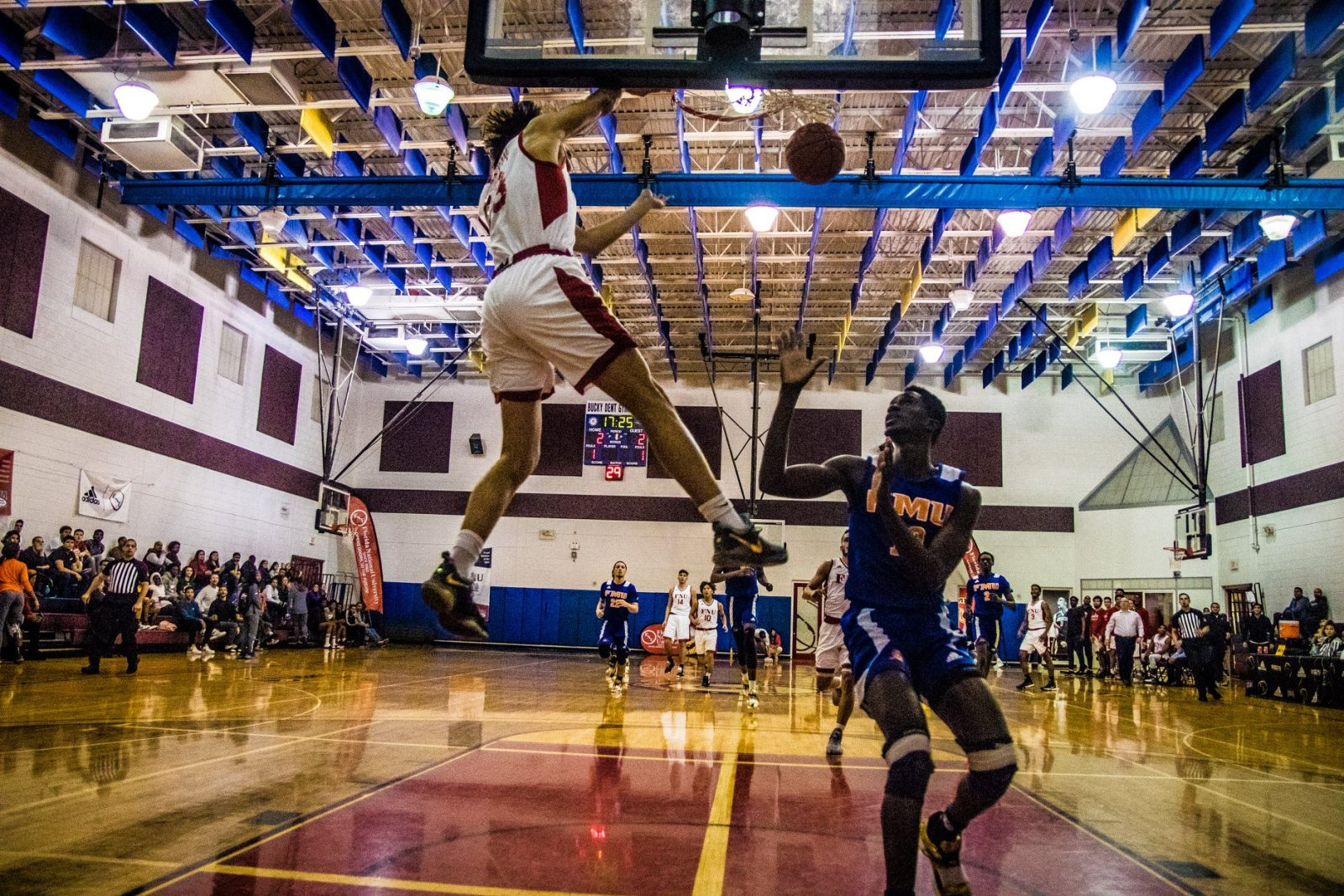 FNU Basketball player Jeffrey Dunking in the game