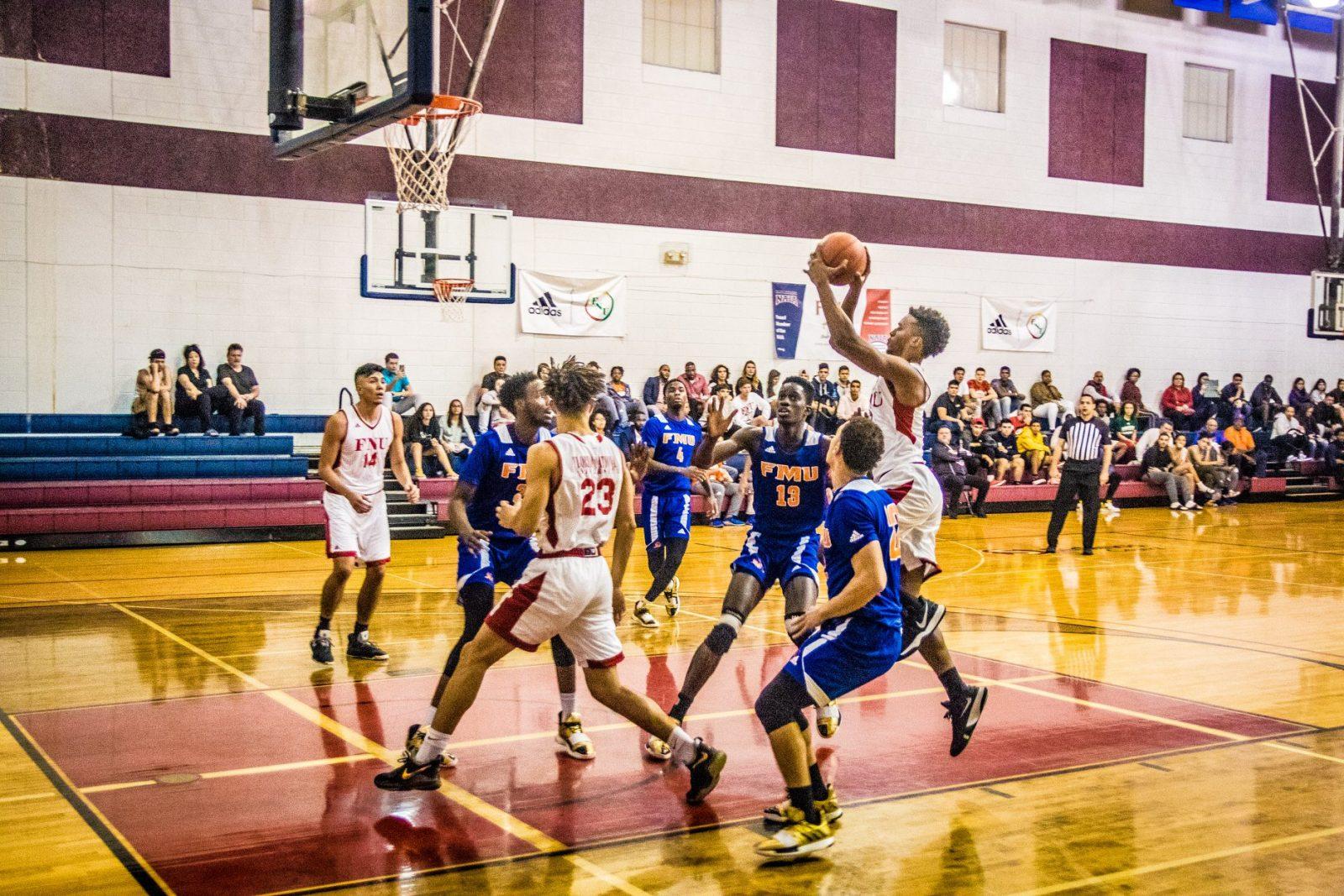 Men's basketball player Jose Benitez Shooting during the game