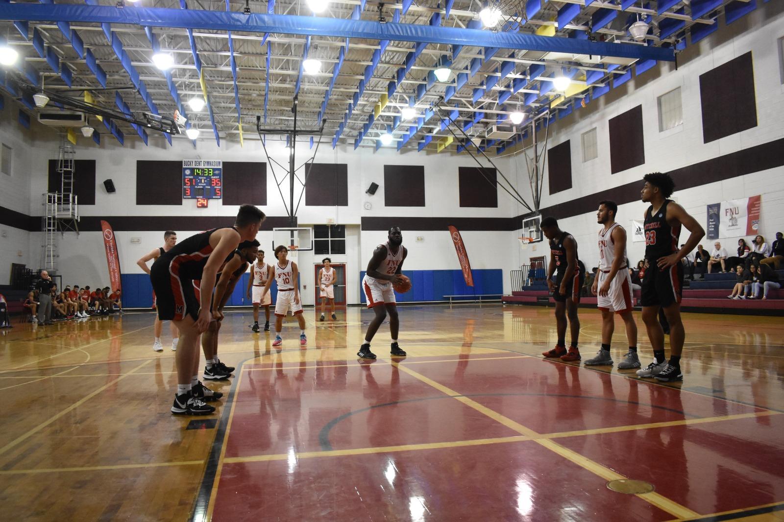 Men's basketball player Denzel shooting the ball