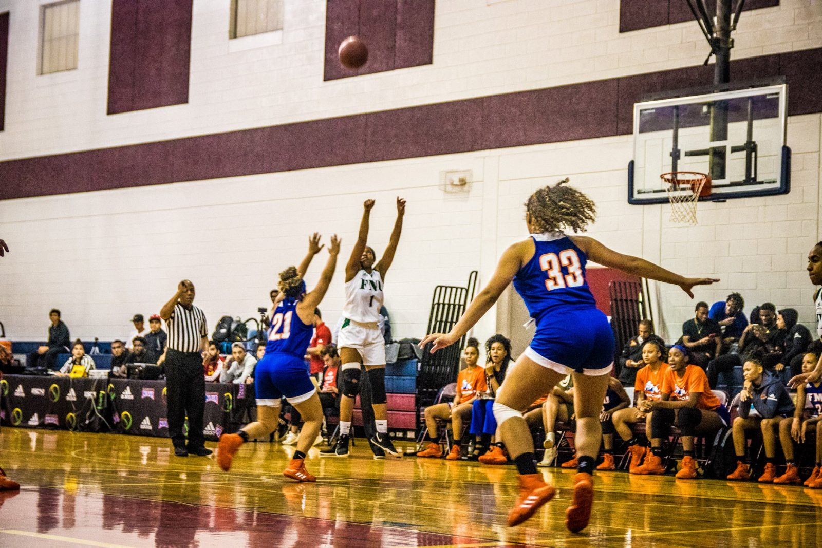 women's basketball player Ashley Williams throwing the ball in the game