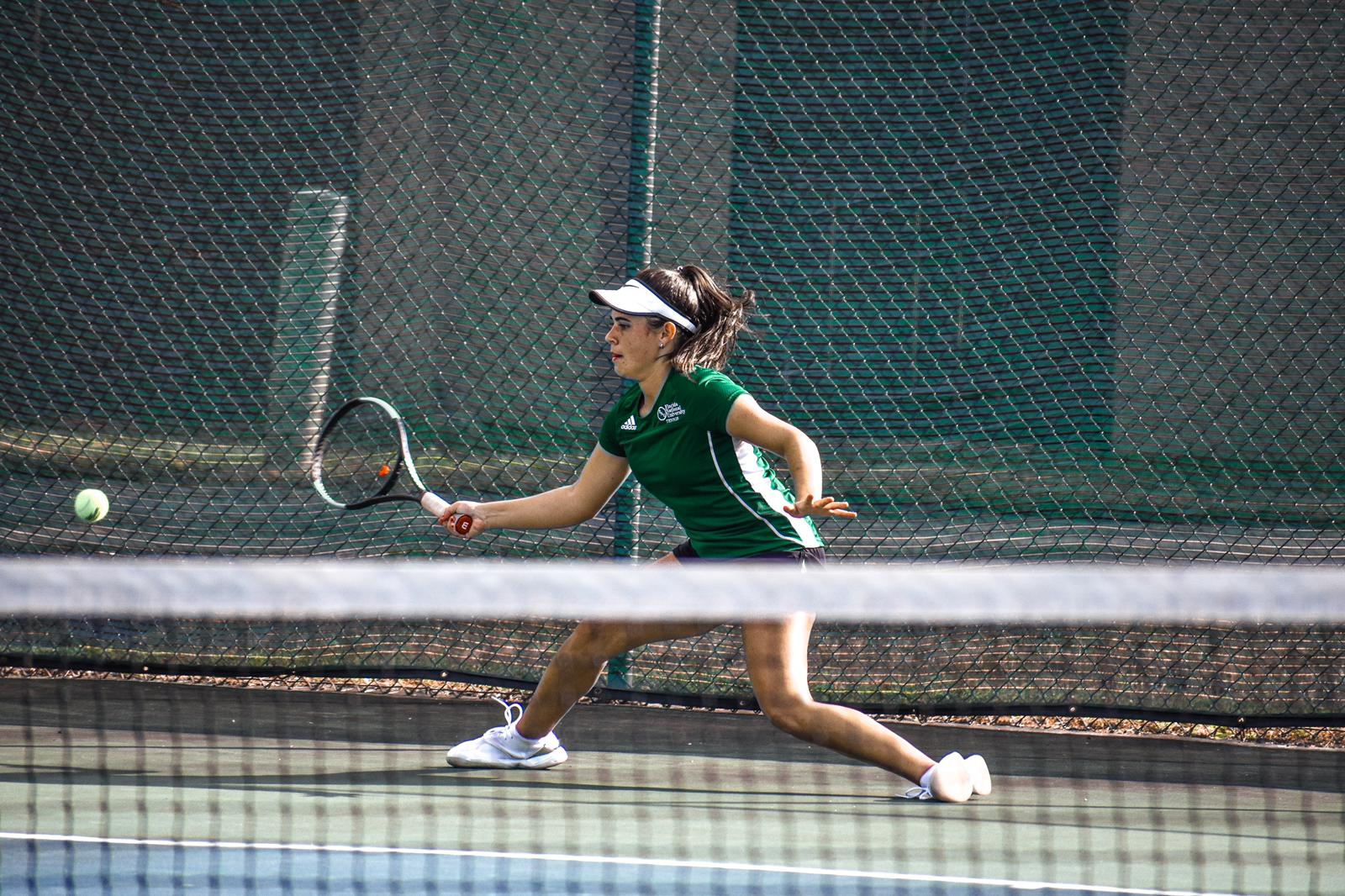 FNU tennis player Candela hitting the ball in the Game