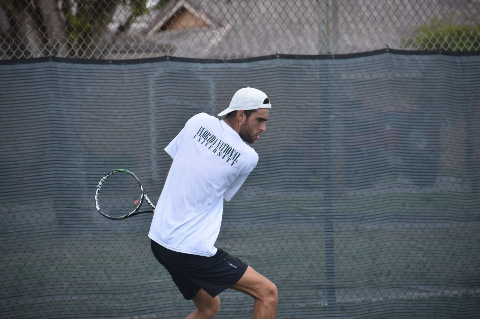 FNU tennis player hitting the ball