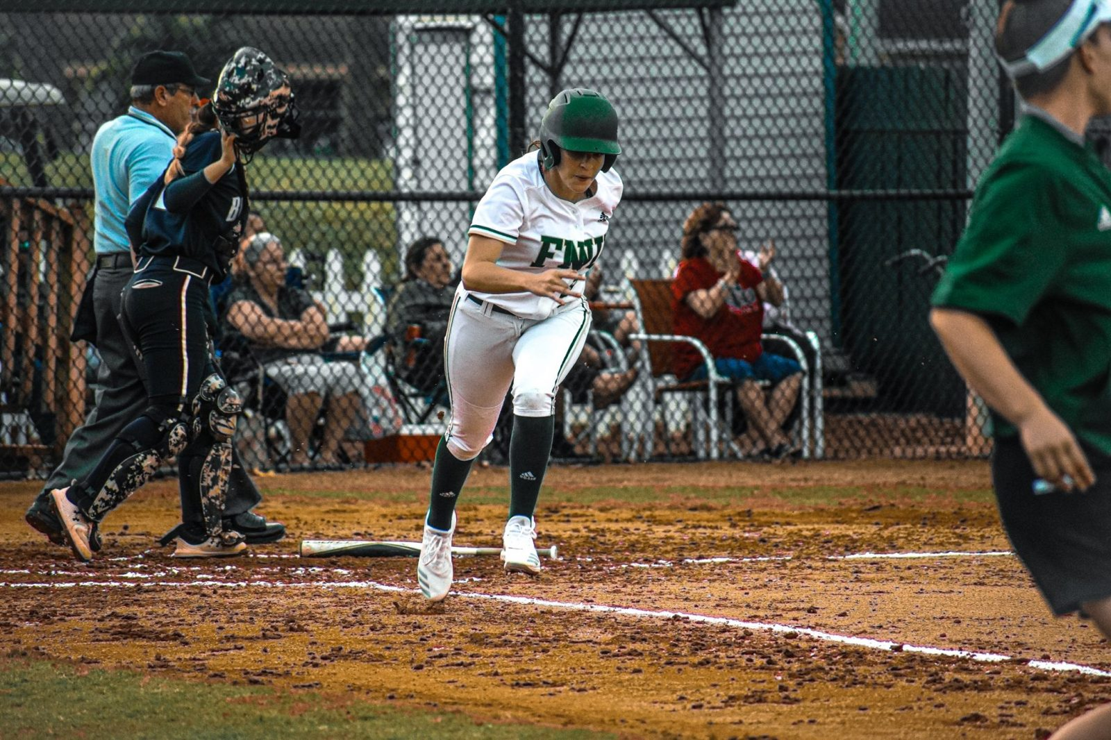 FNU softball player running in the game