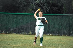 softball player throwing the ball