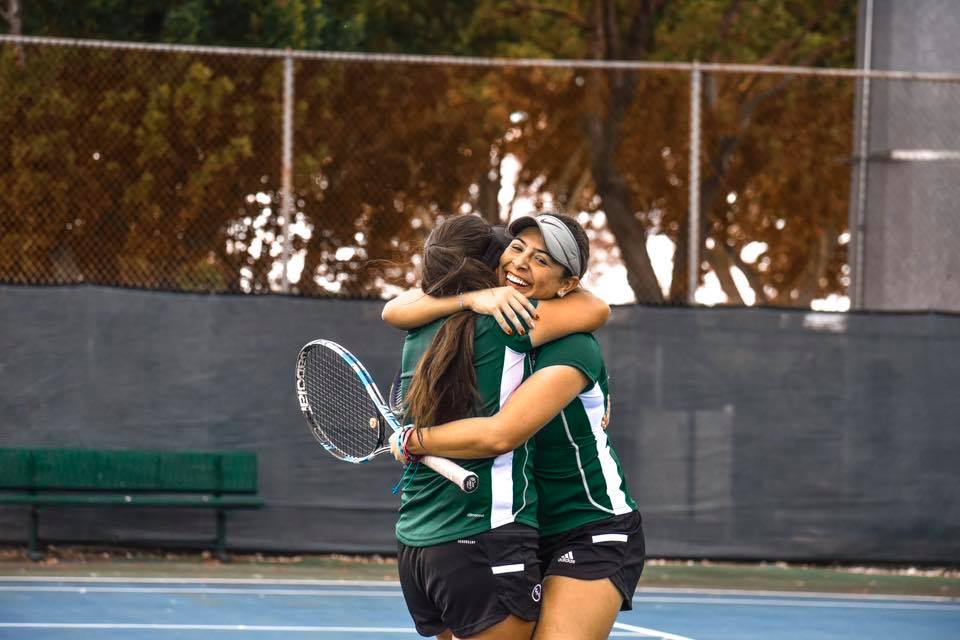 FNU tennis players celebrating