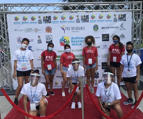 Women's Soccer Team Volunteering at Austism Soccer 5k Walk on September 19th, 2020