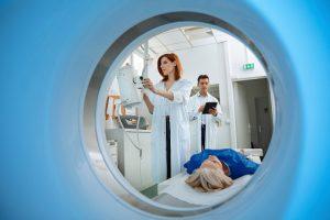 medical professional performing MRI